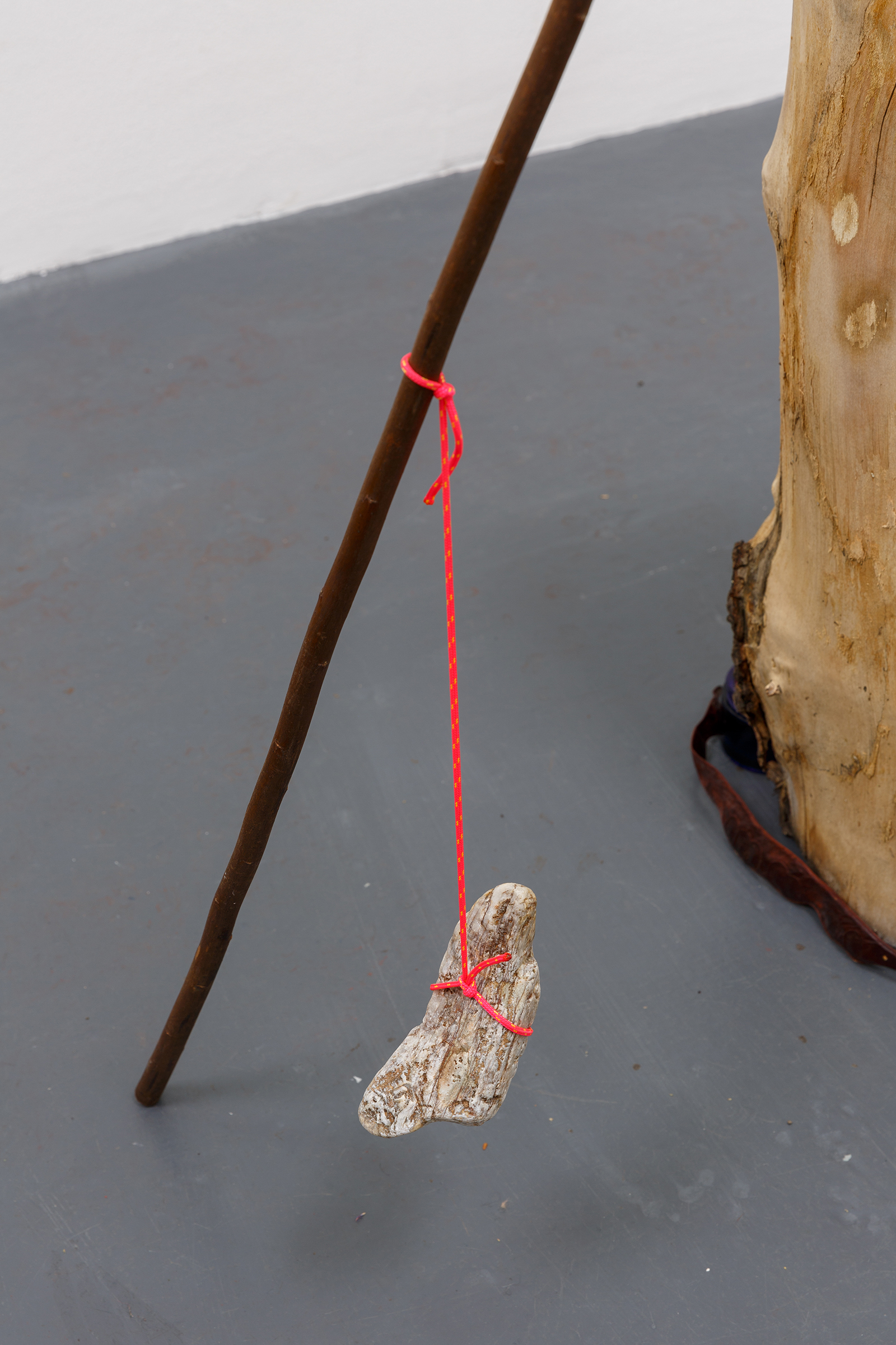 Please come (detail) — Collaboration with Leah Stewart: Hand-dyed silk: Oak, Black Bean, Onion, Coppiced Willow poles, rope, stone, 2019.