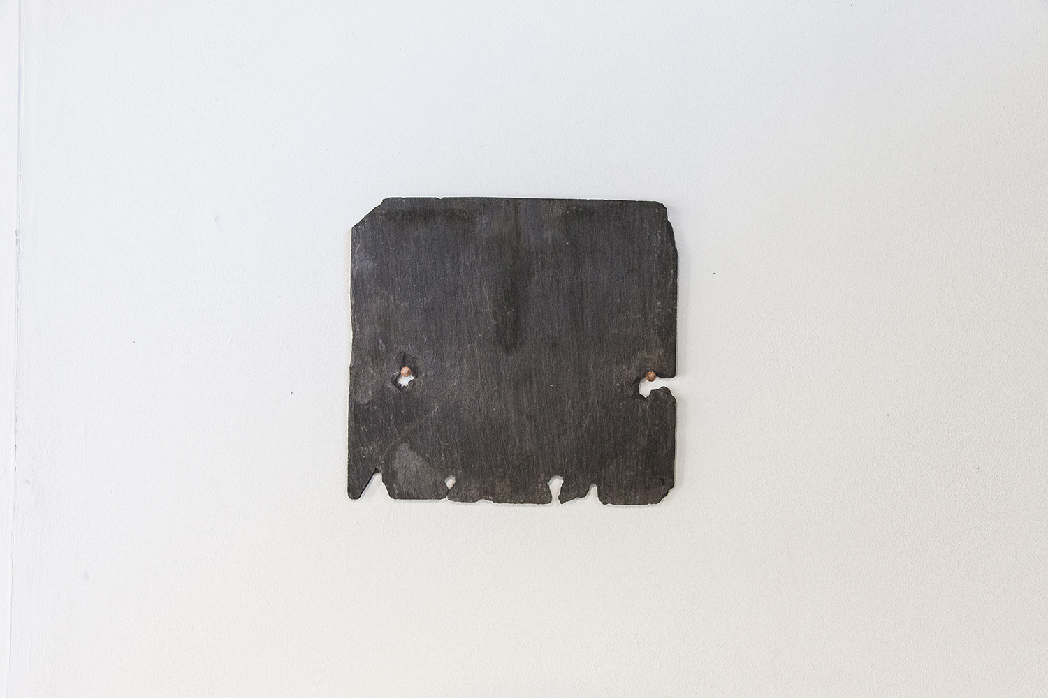Face — Slate and copper nails, 2019.