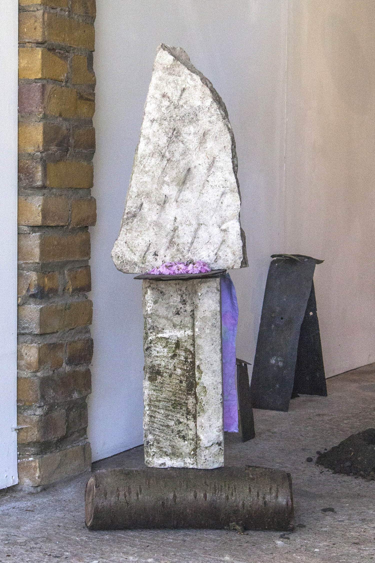 Temporary Energy (Cherry Blossom Rain Stack) — Found stone, slate, charcoal, cherry blossom, log and dyed fabric, 2019.